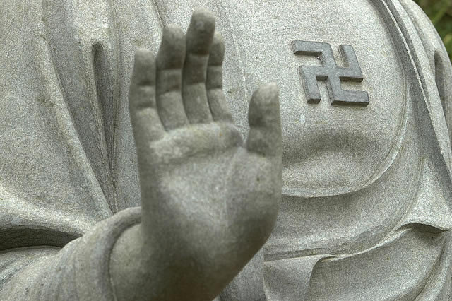 Swastika on a Buddha statue