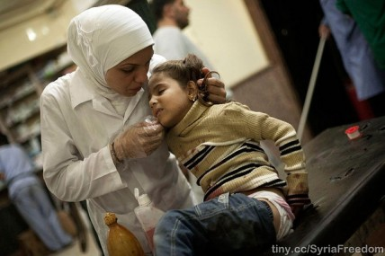 A nurse cares for an injured girl in Syria after her house was bombarded in an attack