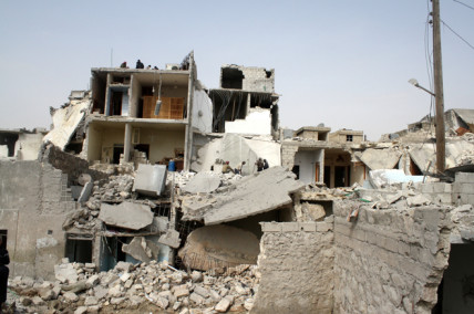 At least a dozen houses were destroyed in an attack on the Jabal Badro neighborhood in Aleppo city on February 18, 2013.