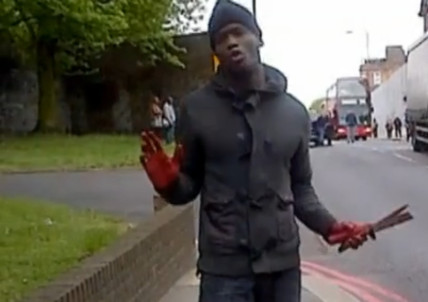 Woolwich attacker brandishing a knive with bloodied hands