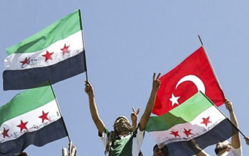Syrian refugees wave Turkish and Syrian Independence flags