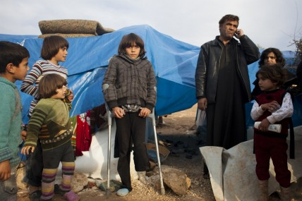 Displaced Syrians at a makeshift camp at Qah in the north of the country