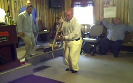 Pastor Coots handling snakes during a service at the Full Gospel Tabernacle In Jesus Name in Middlesboro, Kentucky in 2011