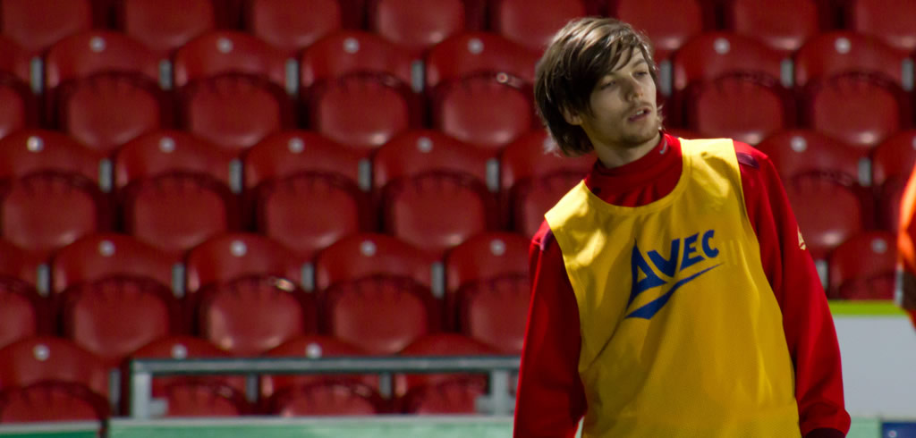 Louis Tomlinson playing football