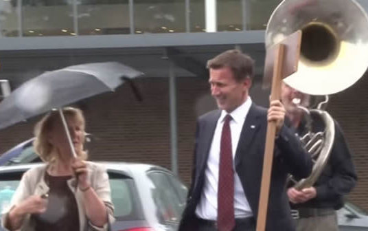 Jeremy Hunt trolled by a man playing a sousaphone