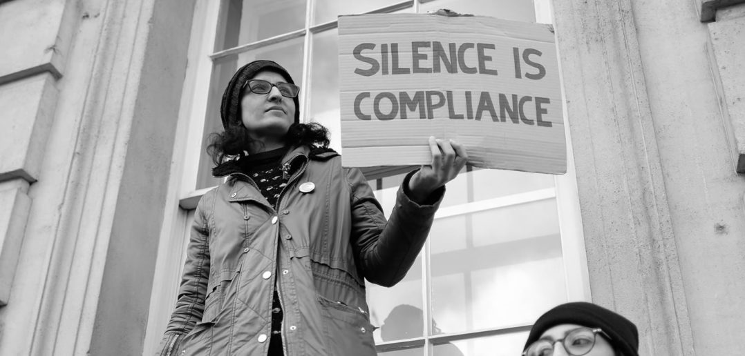"""Silence is compliance"" anti-Trump protest sign"