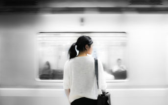 Asian woman at a train station