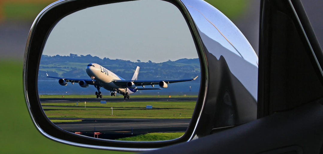 Aeroplane in car wing mirror